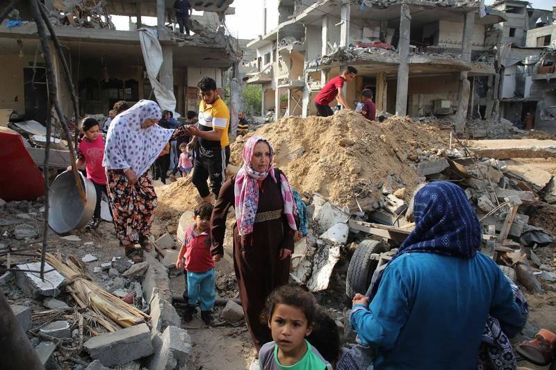5月21日,巴勒斯坦民众重返位于加沙家园,很多地方已是一片废墟。 图源:CFP